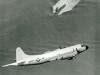 Lockheed P-3B Orion flying over submarine