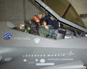 Lt. Col. James Kromberg adjusts his helmet as he prepares to fly the F-35 Lightning II Jan. 30 at the Lockheed Martin facility at Naval Air Station Fort Worth, Texas. Colonel Kromberg\'s test flight marks the first time a military pilot flew the F-35. He is the 461st Flight Test Squadron director of operations. (Courtesy photo- USAF)