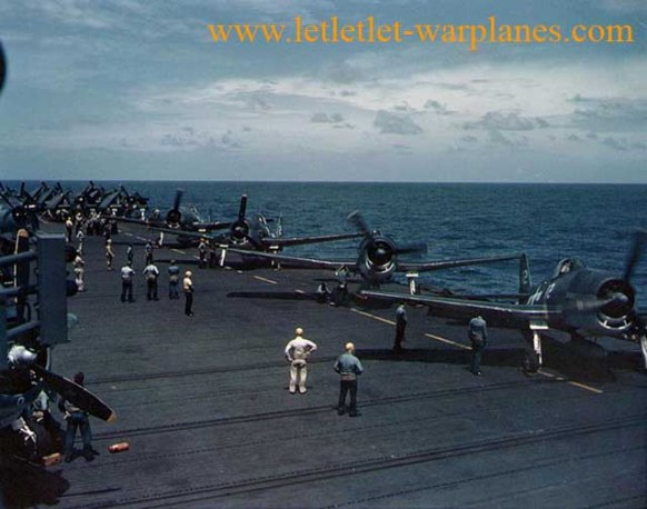 F6F fighters warm up aboard USS Cowpens (CVL–25), January 1944 [US Navy]
