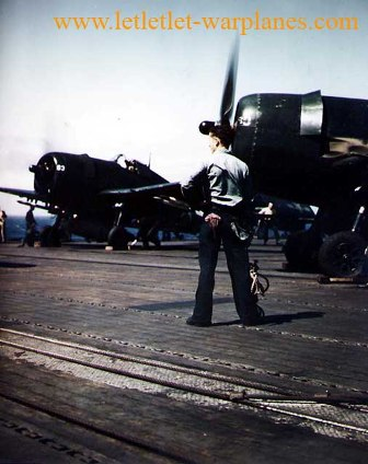 F6F-5 warming up on deck of USS Bennington (CV-20), 1945 [US Navy]