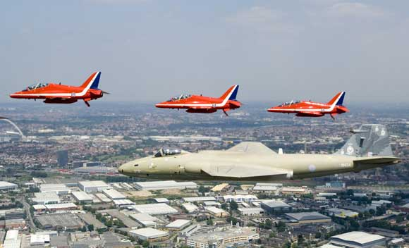 EE Canberra PR.9 XH134 with the RAF Red Arrows as part of the Queens flypast in 2006