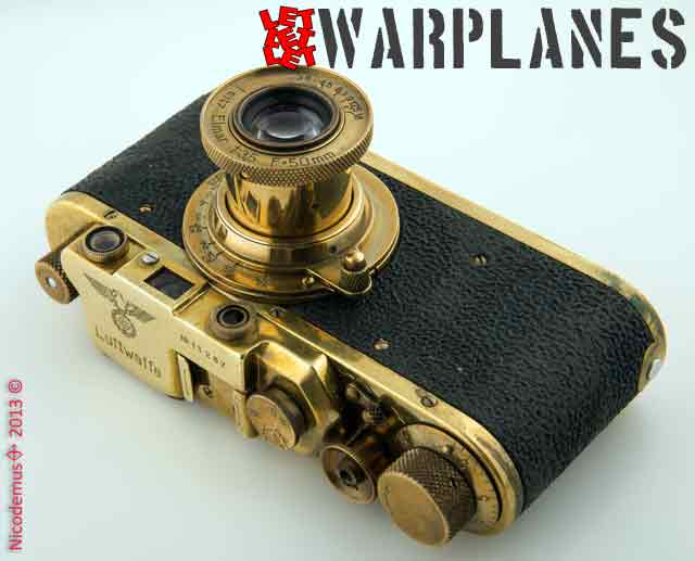 The camera that made German wartime photographers famous: the Leica IIIf; here in Luftwaffe version. There are a lot of fakes where standard Leica IIIf's were refurbished as Luftwaffe camera since they had a much higher price for collectors. Most likely the camera on this picture also is a fake! Photo credit- Nicodemus Roger