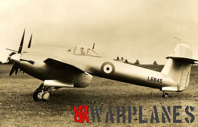 The second prototype L6845 in aluminium colour scheme with Westland chief test pilot Harald Penrose in the cockpit. Note the mudguards fitted on the main wheels. At the production Whirlwind these were omitted. We also see the small acorn shaped filler at the tail that was later enlarged on the production type!