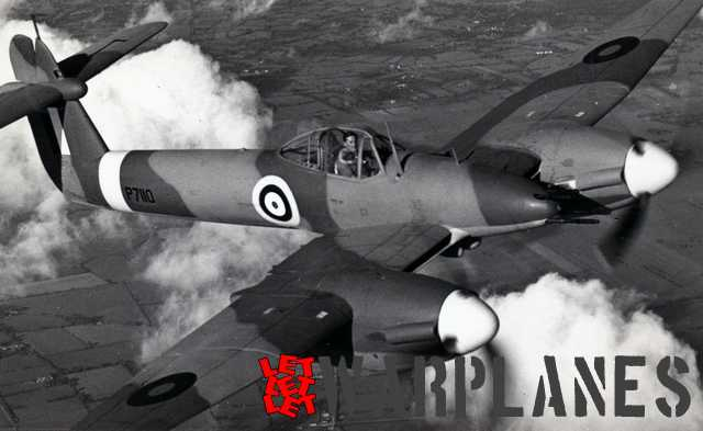 P7110 with test pilot Harald Penrose in the cockpit during a photo session flight. Photo was taken from a Westland Lysander.