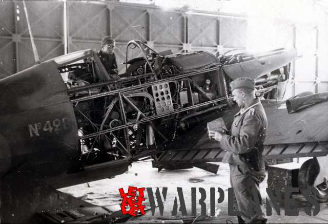 German technicians examine a sample machine captured at Dijon. With panels removed it shows all of the airframe construction and interior content. The M.S. 406C1 is of the tubular frame construction which mean ease of repair and capable battle damage resistance but on the other hand also mean a weight penalty. (Daniel Gilberti)