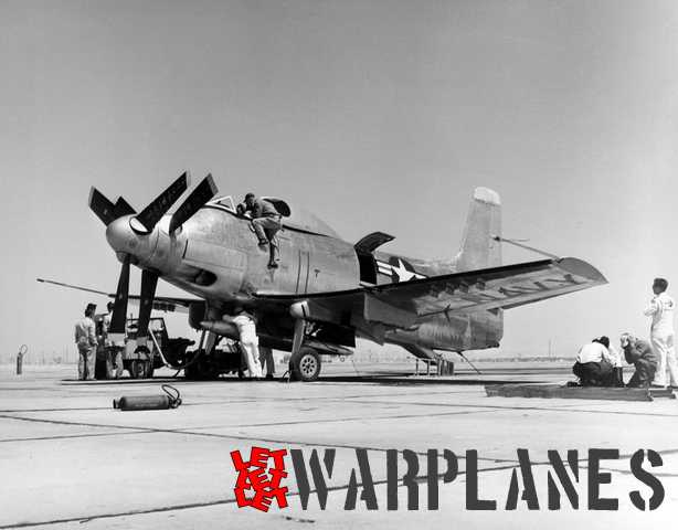 Douglas mechanics working on XA2D-1 no. 2 at Edwards with the engine inspection panel opened