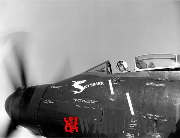 Douglas test pilot 'Doc' Livinston in the cockpit of a production A2D-1. The photo was taken on 19 August 1955. The Skyraider was one of the machines bailed to Allison for engine testing. Most likely it was BuNo. 125484; the last Skyshark to be delivered and flown. The Skyshark figure and name are remarkable.