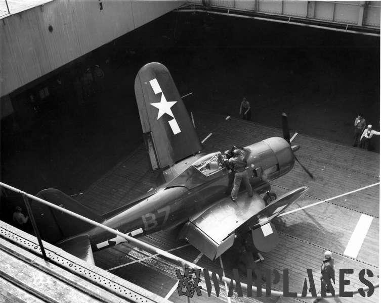 FR-1 'B7' from VF-66 in the hangar lift of aircraft carrier USS Ranger
