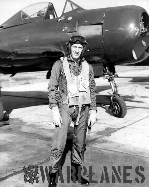Lt Commander John Gray of VF-66 in his flying clothes standing in front of an FR-1